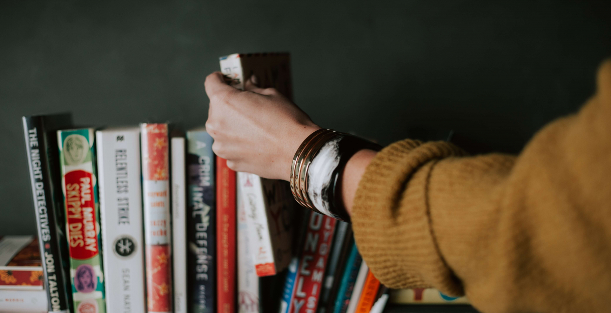 Girl reaching for a book