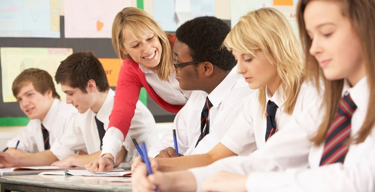 Karen Walshe MA Education testimonial blog header - teacher and students in a classroom